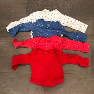 Four Carter's long sleeve onesies